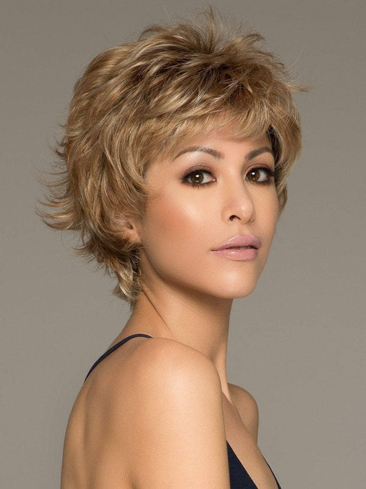"Noriko Mason has mixed layers with beveled ends build attitude into this style with a sophisticated ""kick"""