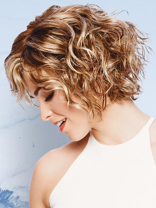 This chin length, layered crop has the same barrel curls, blunt cut sides and bottom