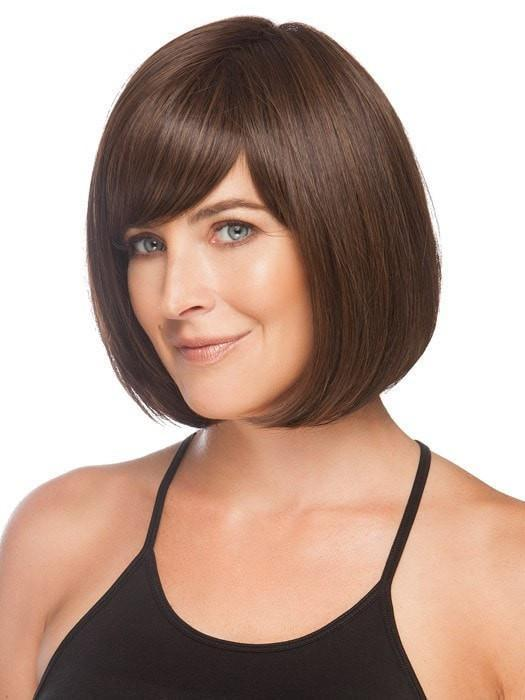 Layers wrap below the jawline giving all face shapes a flattering look | Color: Medium Brown