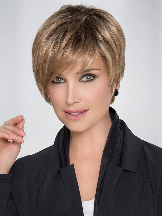 "An amazingly versatile, asymmetrical precision cut with a fringe that adds that little something ""extra"""