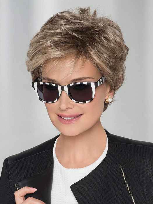 A voluminous short wig, perfect for the woman who wishes to add a touch of elegance
