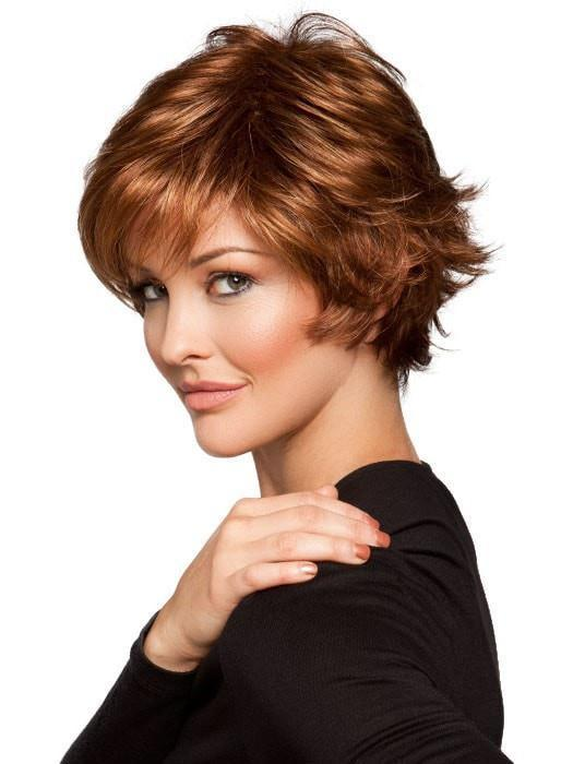 A short, textured and layered cut with a wispy bang and flipped ends