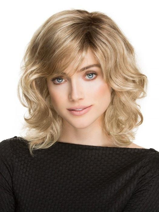 A voluminous, shoulder-length wig with a wavy texture all over