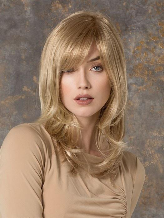 Smooth and straight with a soft side bang and wispy, flipped ends