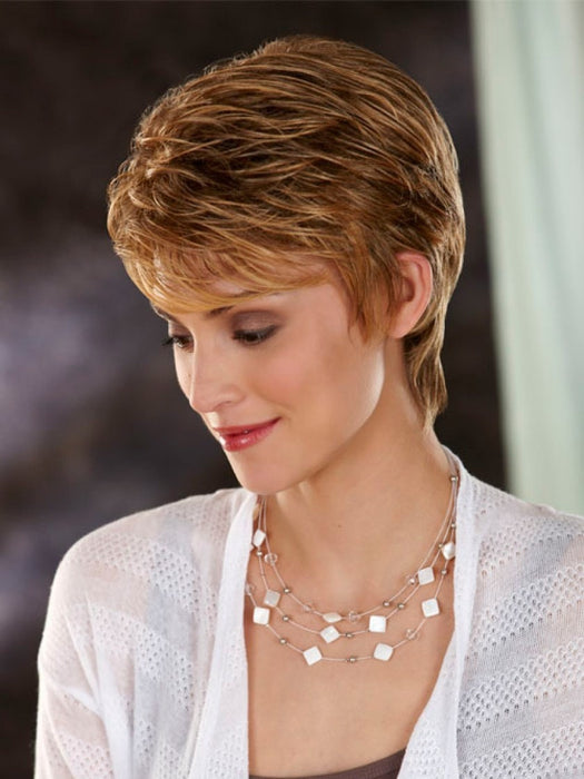 Nina is a short-length wig with textured, uneven length hair on the top & sides and a tapered neckline.