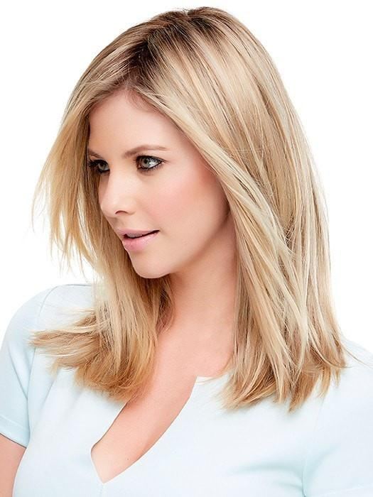 A great clip in hair topper that integrates easily with your own hair at the crown to add body and volume