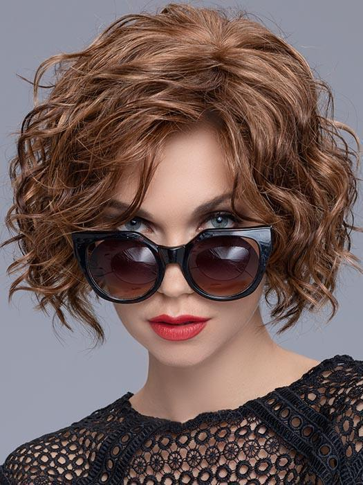 "With a perfect fringe measuring at 8"" that naturally sweeps to the side, this style will flatter every face shape"