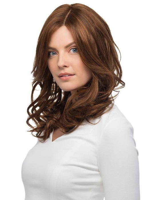 A gorgeous, long Remi human hair wig with soft curls and free-flowing layers