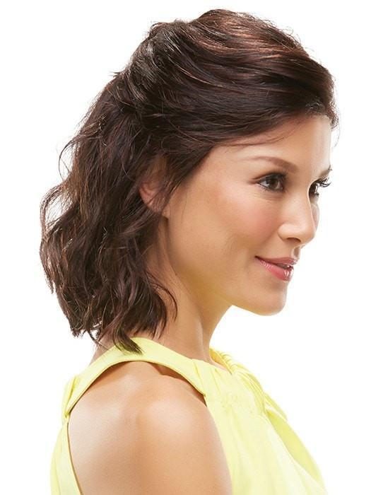 Styled half up with loose waves in front of the ear