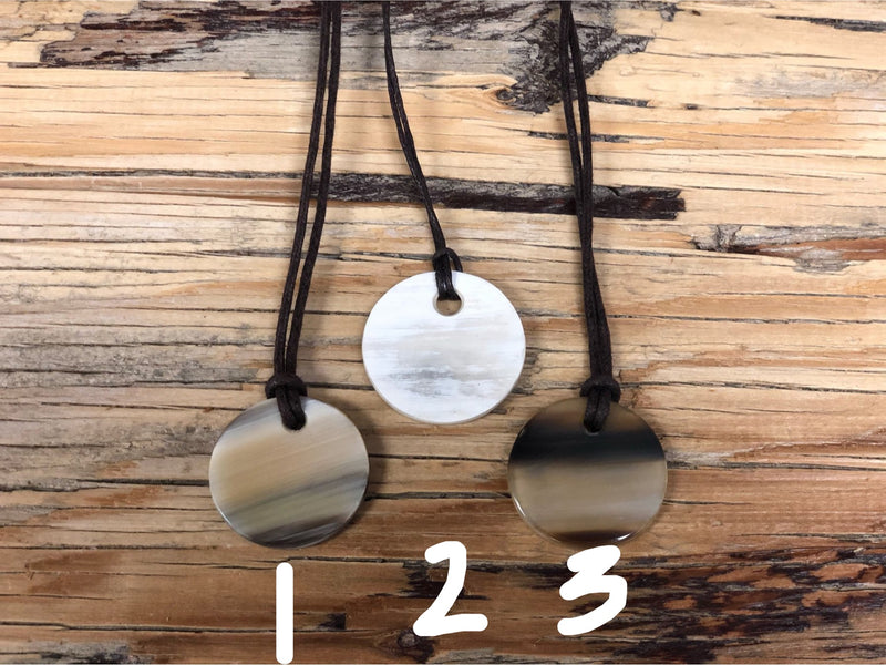 "Cowhorn necklaces - 1.25"" circle"