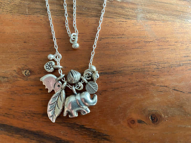 Necklace - silver chain w/elephant cluster