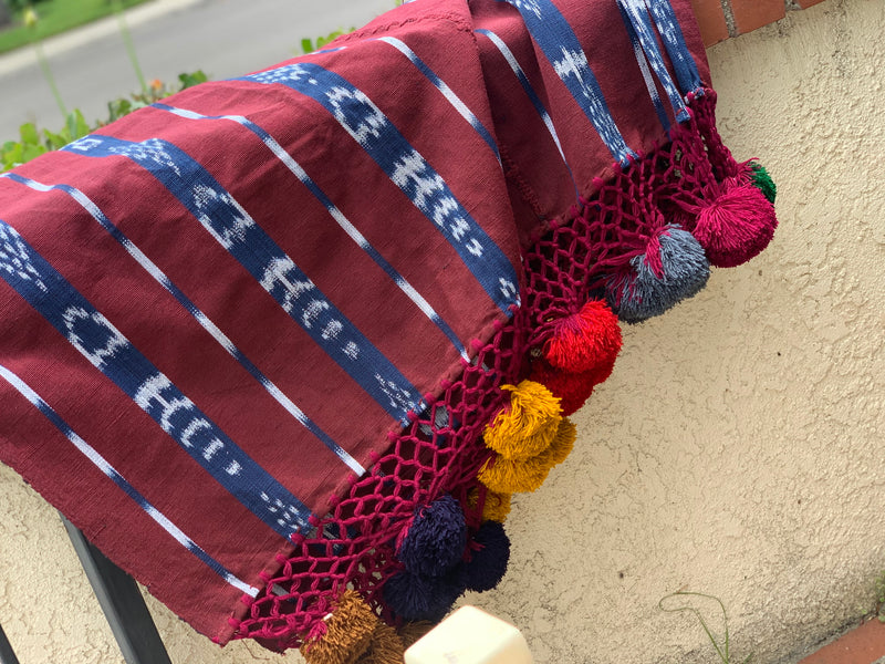 Foot loomed blanket with pom poms