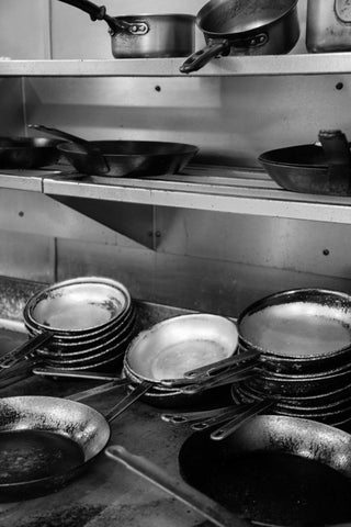 Print of skillets pots and pans at a restaurant