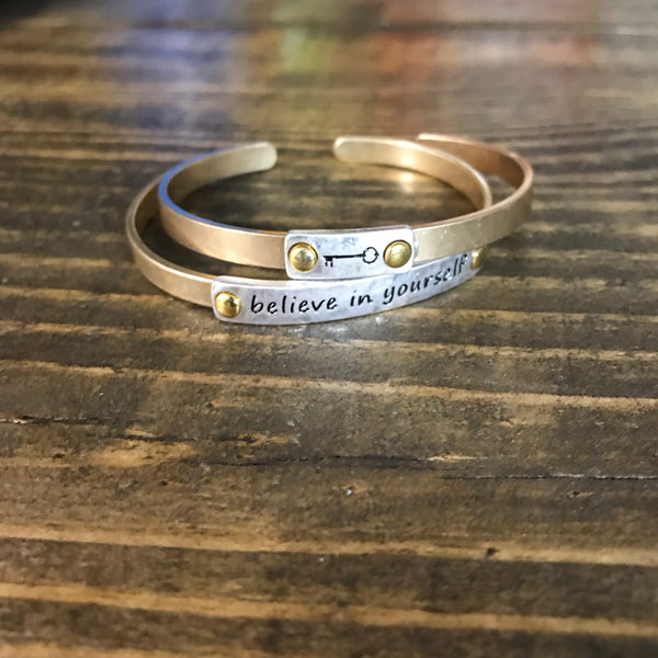 Worn Goldtone with Silvertone 'Believe In Yourself' Cuff Bracelets