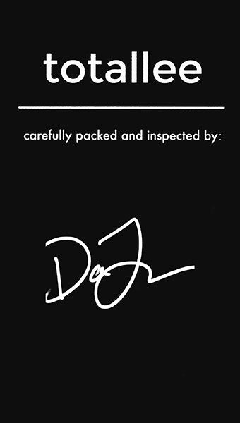 Black warranty card signed by totallee staff member David