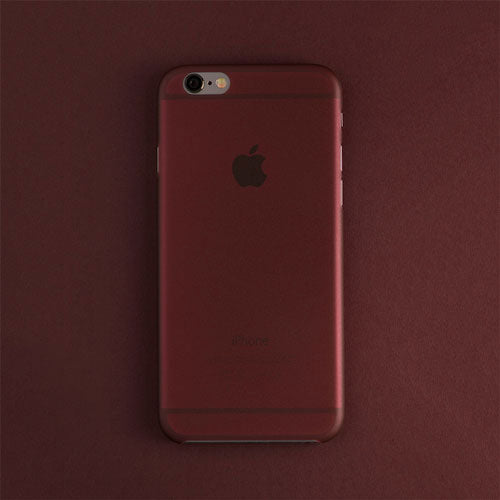 Back view of a burgundy red thin iphone case on a burgundy red background