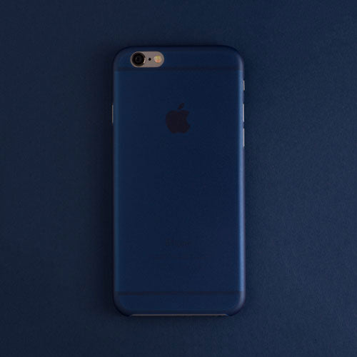 Back view of a white navy blue iphone case on a navy blue background