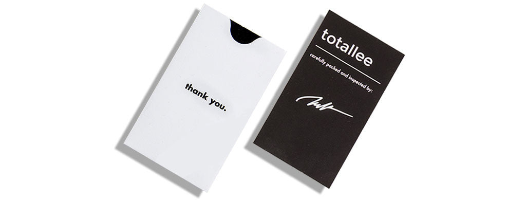 "totallee packaging -- ""thank you"" sleeve and signed warranty card"