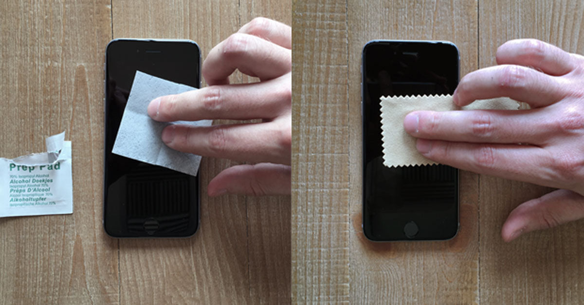 Cleaning an iPhone screen with an alcohol wipe and microfiber cloth