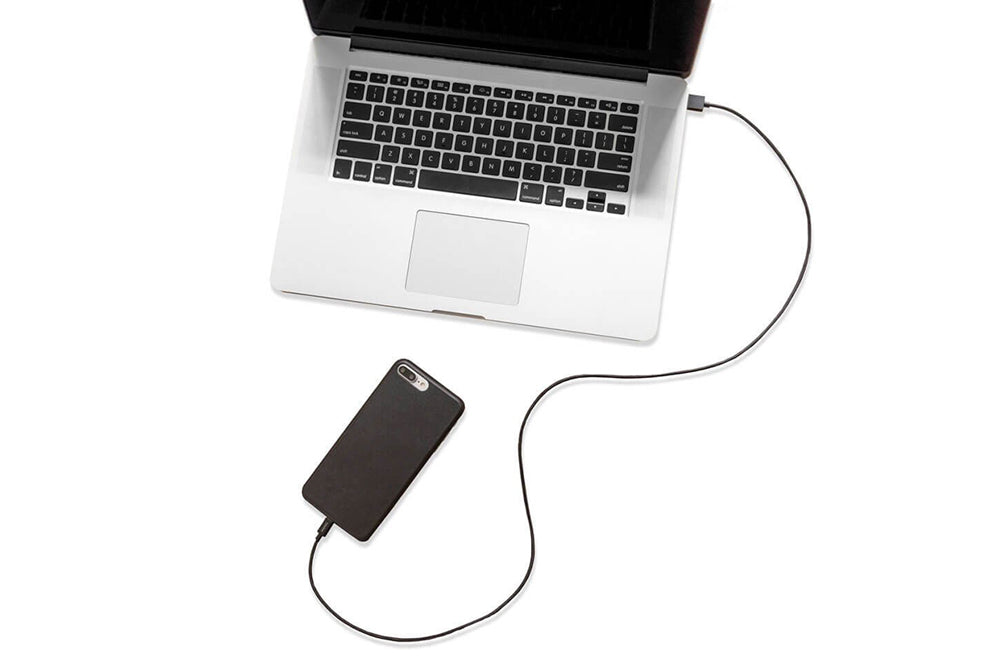 iphone charger cable by totallee attached to macbook