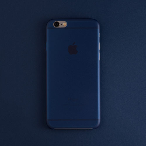 Back view of the navy blue scarf iphone case on a navy blue background made by totallee