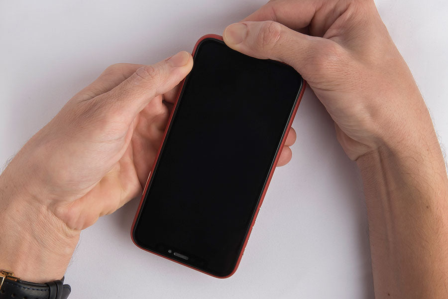 Step 2 - removing the corner diagonally opposite the volume buttons