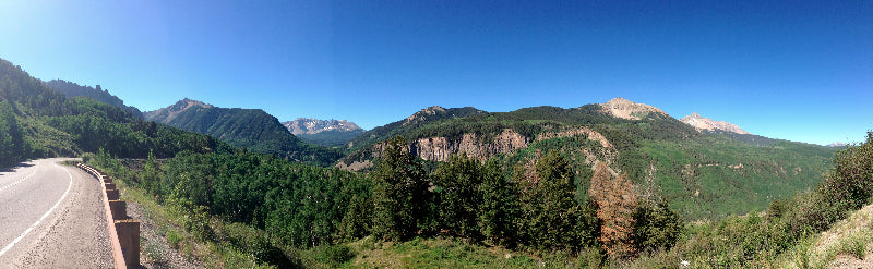 A panoramic image of mountains and trees
