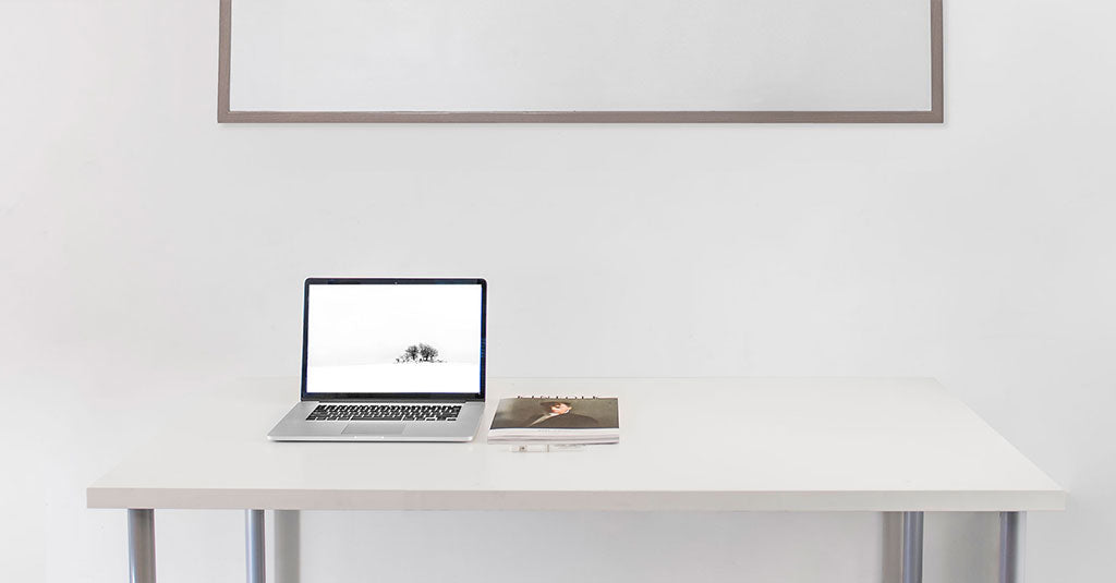 desk with a laptop and computer