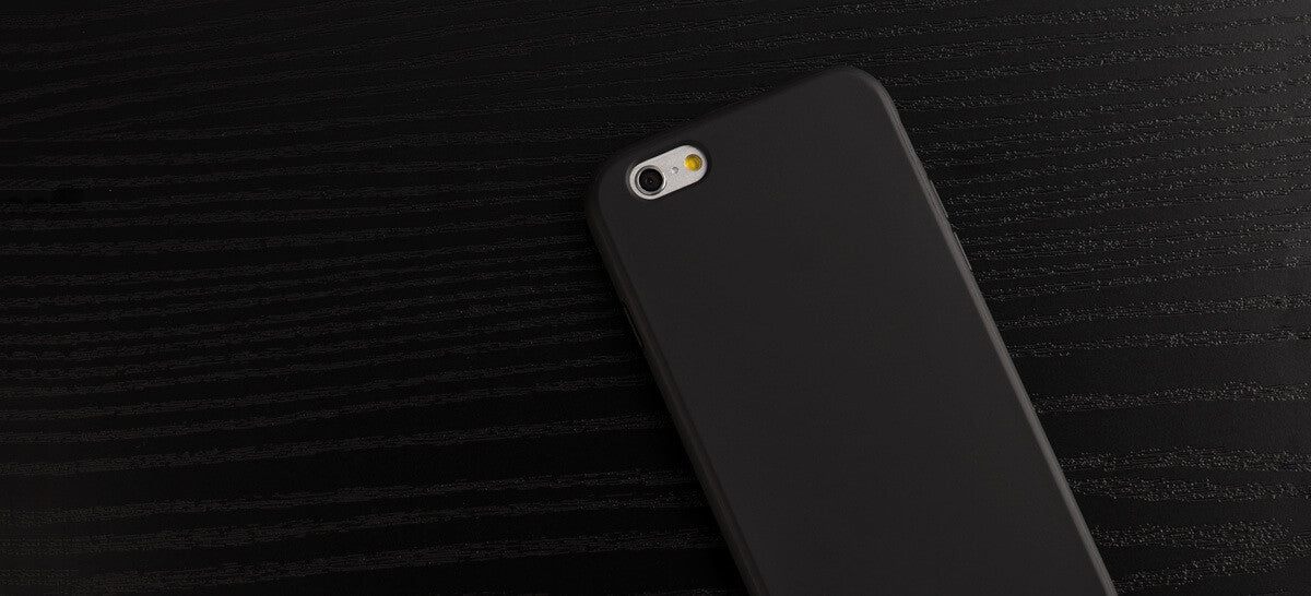 A black rubber iPhone case, made by Totallee