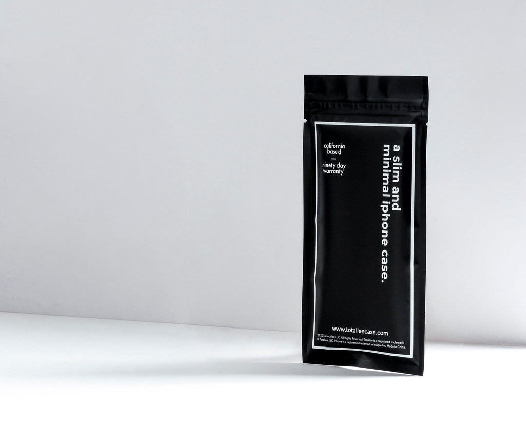 totallee's minimalistic black bag packaging