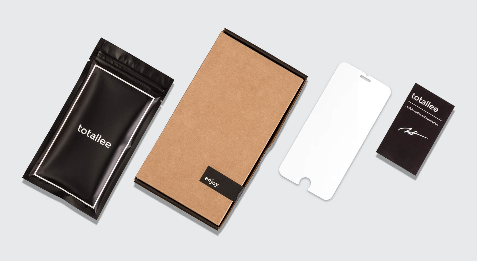 totallee's no bubble screen protector and packaging, including a kraft box, black bag, and a black hand signed warranty card