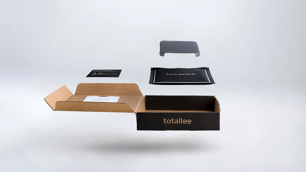 totallee's packaging: a hovering thin iphone case, blag bag, black warranty card and kraft cardboard box