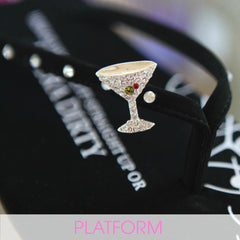 Black designer flip flops with martini glass jewelry