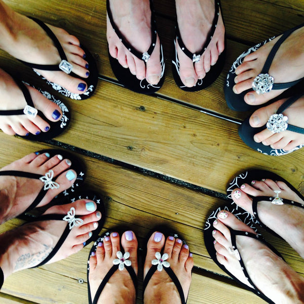 Girfriends wearing black flip flops