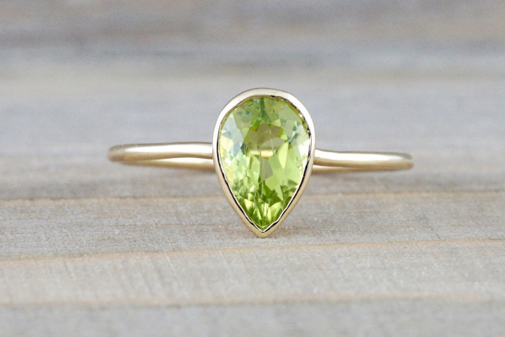 0.83 carats Green Peridot set on Solid 14k Yellow Gold Pear Shape Bezel Band Ring - Brilliant Facets