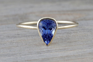 Tanzanite  set on Solid 14k Yellow Gold Pear Bezel Band Ring