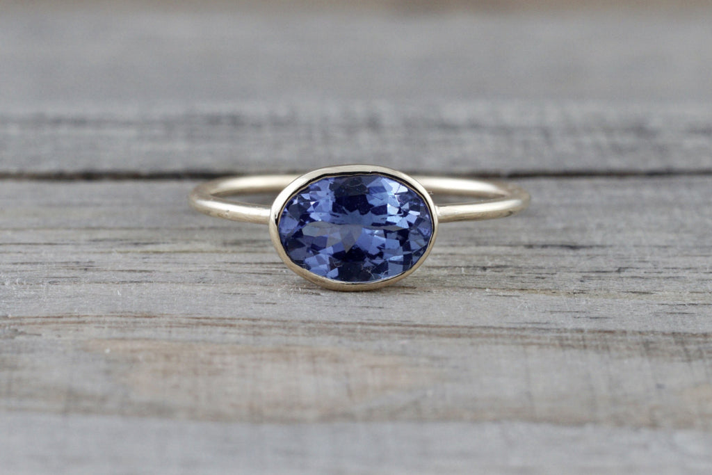 0.80 Carats Exotic Tanzanite is set on Solid 14k Yellow Gold Oval Bezel Band Ring - Brilliant Facets