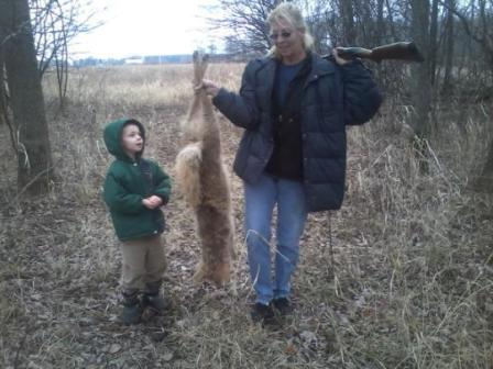 Sheri Chagnon with Grandchild Tobyn Slater with Nice Michigan Coyote using Lenon's Super All Call Lure