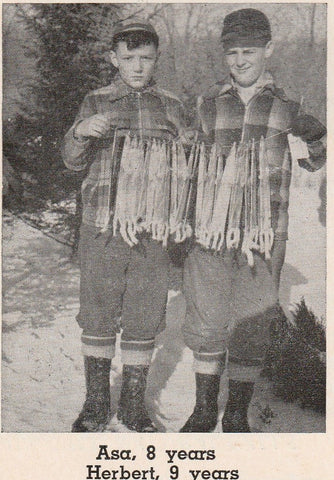 Asa and Herb Lenon Showing Weasels Trapped in Michigan