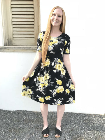 modest yellow and black floral dress
