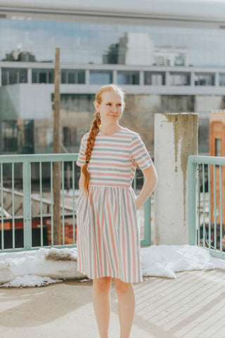 Modest dress with light colored stripes