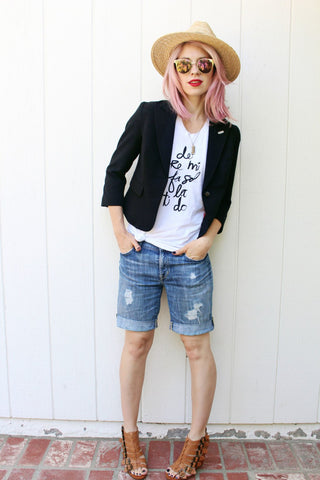 Outfit featuring distressed shorts, graphic tee, and blazer.