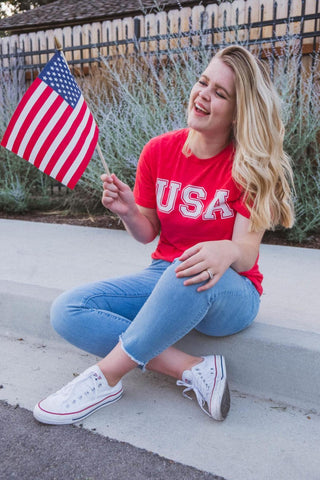 Kayla Smith wearing an outfit with red, white and blue.
