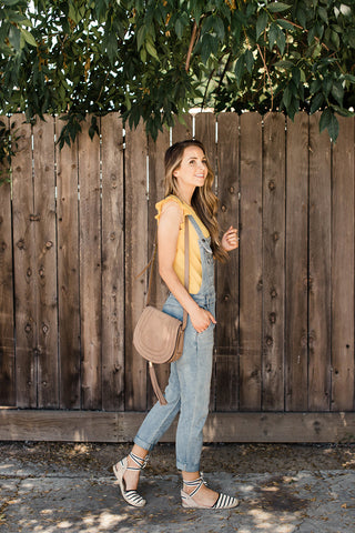 Merrick White shows you how she styles her light wash overalls