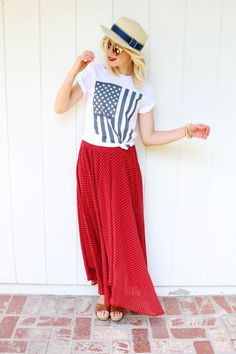 4th of July outfit featuring a red maxi skirt and an american flag t shirt.