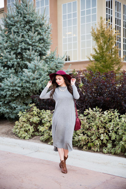 Emily Smith wearing our long sleeve grey dress