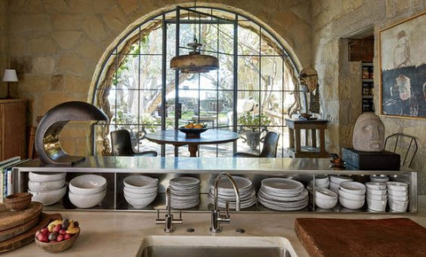 rounded french window in a light and bright kitchen with open storage and pottery - Saladino