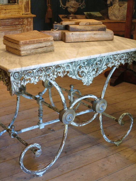 Chez Pluie marble top butchers table with decorative cast iron base