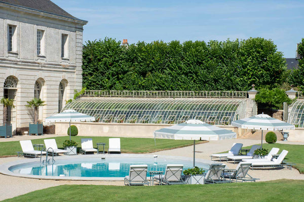 Round swimming pool classic French garden Chateau du Grand Luce