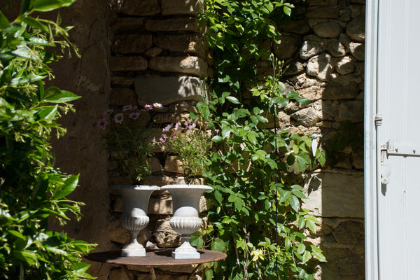 Pair of Medici urns in french garden